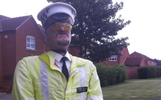 'Police' scarecrow used to slow traffic