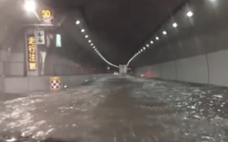 Watch a Tokyo commuter drive through a flooded tunnel