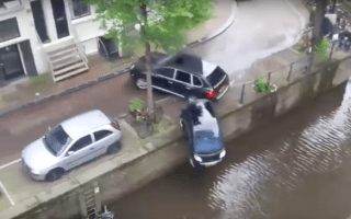 Porsche Cayenne filmed slamming Smart car into canal