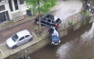 Porsche Cayenne filmed slamming Smart car into canal
