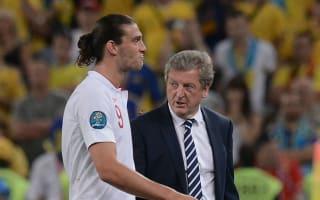 Hodgson talks down Carroll's Euro chances