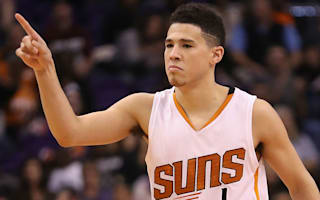 Booker explodes for 70 points against Celtics, but Suns lose