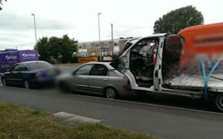 Police stop car towing another car with a van wedged in the boot