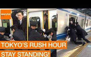Watch passengers forced into packed train during Tokyo rush hour
