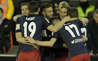 Valencia 1 Atletico Madrid 3: Torres and Carrasco keep title hopes alive