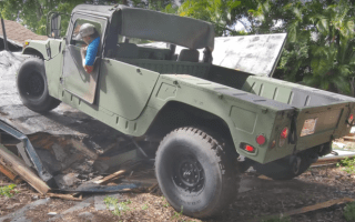 Using Humvees to pull apart a house looks like awesome fun