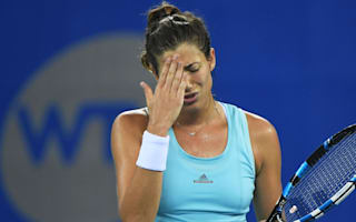 Muguruza slump continues, Kerber wins first match as number one