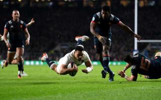 Te'o the hero as England scrape home to set record