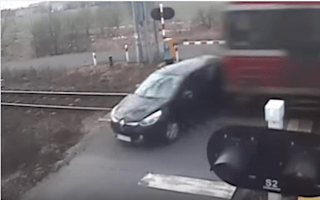 Video shows horrifying crash involving train and car