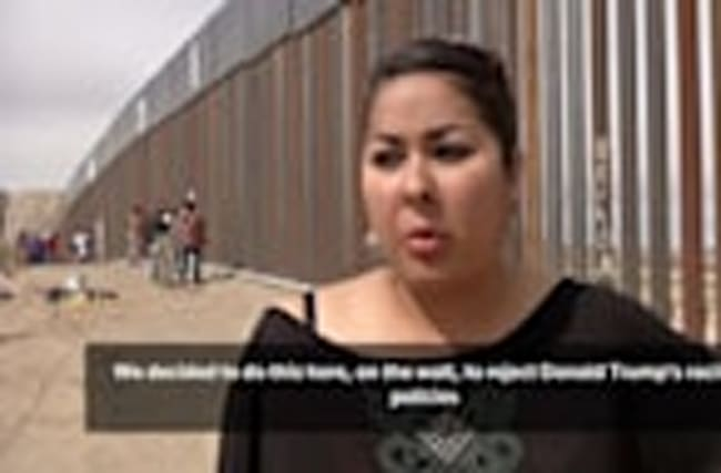 Mexican activists paint U.S. border wall with message to Trump