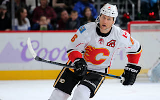 Flames' Wideman suspended 20 games for hit on linesman