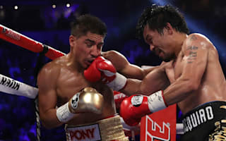 Pacquiao wins welterweight title in boxing return