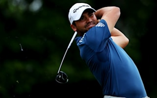 Day extends lead as weather disrupts second round