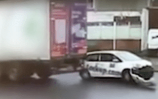 Woman sees her parked car dragged away by lorry