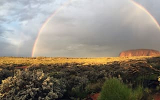 Stunning rainbow pictured over Australia's famous Uluru landmark