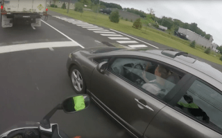 Instant karma for driver who cut up biker in merge
