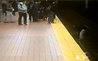 Video: Incredible moment man jumps onto train track to save stranger
