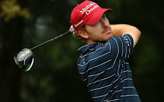 Castro leads in Indiana after suspended first round