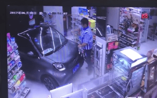 Hilarious moment motorist drives into store and makes cashier grab some snacks