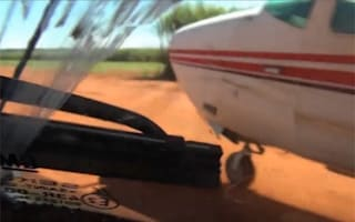 Video shows police stopping drug-smuggling plane with their car