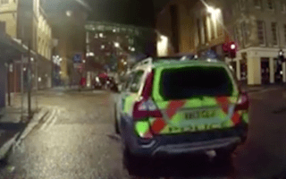 Police car rolls into another vehicle after handbrake blunder