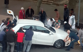 Passers-by lift Mercedes off young boy following crash