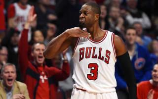 Wade fined $25,000 for throat-slash gesture
