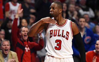 Wade fined $25,000 for throat-slash gesture