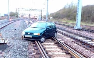 Abandoned car causes commuter chaos near London
