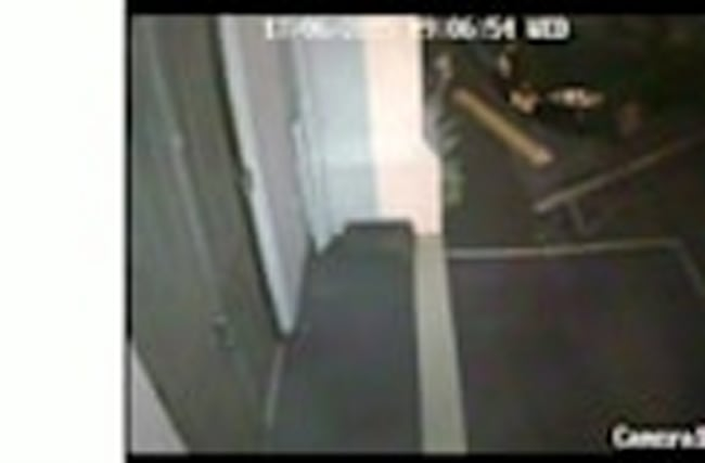Surveillance video shows Roof exiting church holding handgun