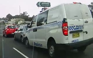 Video: Dozy cop slams into two cars at traffic lights