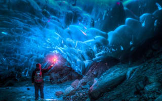 Alaskan ice cave that could collapse any minute: Brave photographer's stunning pictures
