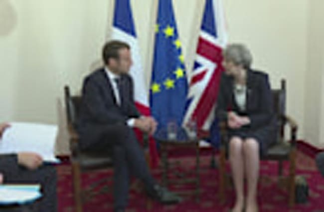 Theresa May meets Macron for first time