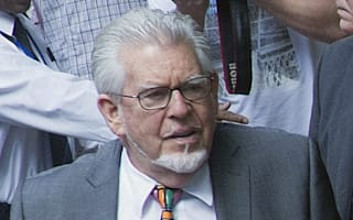 Rolf Harris cleared of three sex charges in second trial