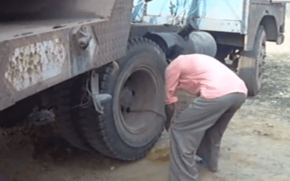 Lorry driver starts truck with muscle power alone