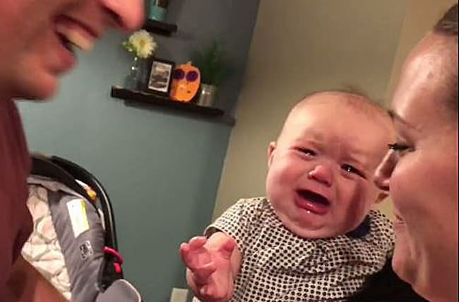 Watch: This baby really doesn't like her parents showing affection