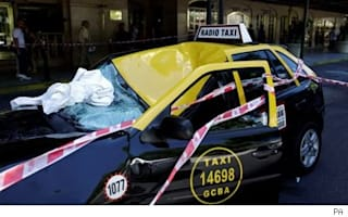 Taxi breaks woman's 23 storey fall