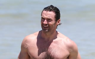 Hugh Jackman shows off toned torso on Bondi Beach in Australia