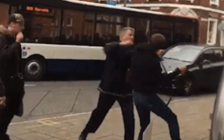 Brawling bus driver in shocking fist fight with pedestrian