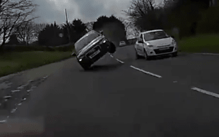 Motorist narrowly escapes hitting car on two wheels