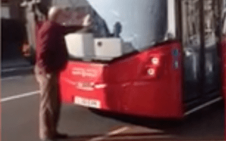 Elderly man holds up traffic on busy London street