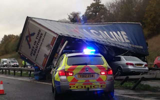 Man survives car being crushed by lorry in motorway accident