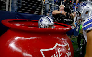 Elliott not fined for jumping into Salvation Army kettle