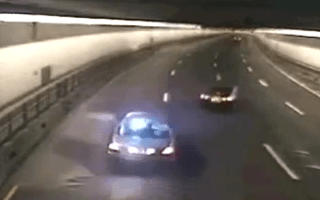 Video: Shocking moment out of control driver narrowly misses police car