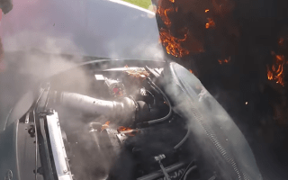 Watch a ridiculously calm driver escape from a flaming drag car
