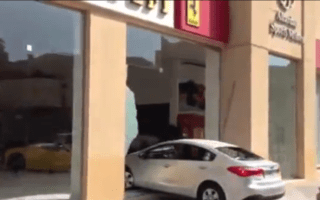 Video: Kia driver crashes through Ferrari showroom window