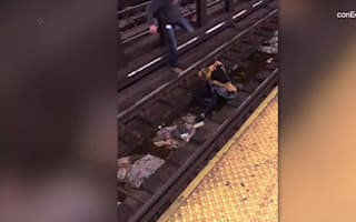 Injured man saved from oncoming subway train