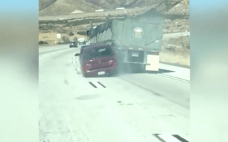Trapped car dragged down highway by oblivious truck driver