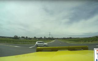 Inattentive Suzuki driver causes truck crash