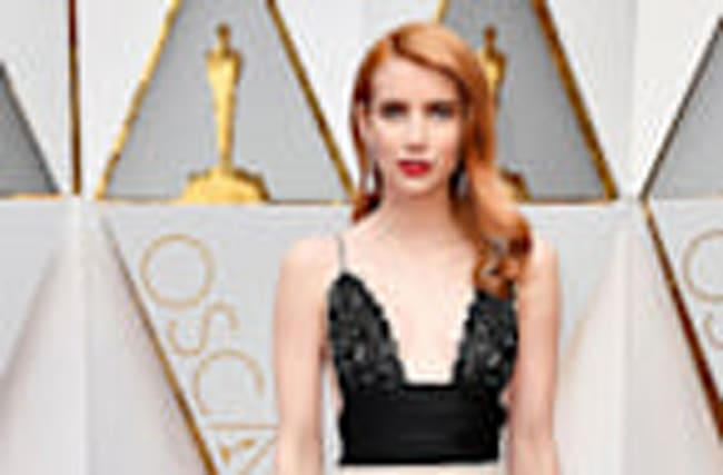 EXCLUSIVE: Emma Roberts Almost Rips Isabelle Huppert's Oscars Dress Nearly 'Faceplanted' on Red Carpet